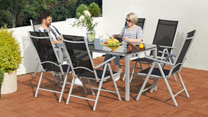 People sitting at a garden furniture set